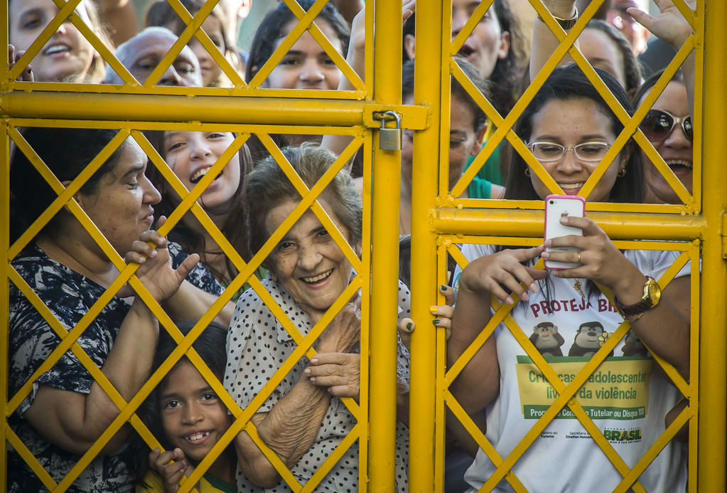 . Brazilian football fans crowd outside the gate as their national team arrives for a training session at the President Vargas stadium on the eve of the FIFA World Cup 2014 quarter-final match between Brazil and Colombia in Fortaleza on July 3, 2014.  ODD ANDERSEN/AFP/Getty Images