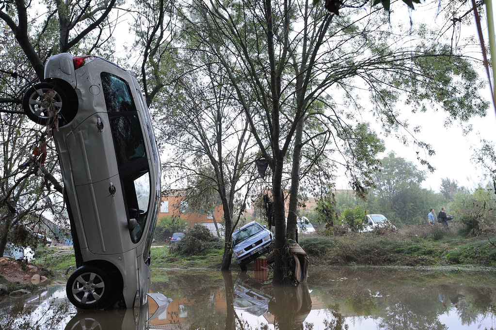 . A picture taken on October 7, 2014 in Grabels near Montpellier shows a car in an upright position following the overnight flash floods due to heavy showers.  Floodwater streamed down roads and highways, engulfing cars as the Lez river burst its banks in the seaside capital of the Languedoc-Roussillon region after it was lashed by record-breaking downpours.    AFP PHOTO SYLVAIN  THOMAS/AFP/Getty Images