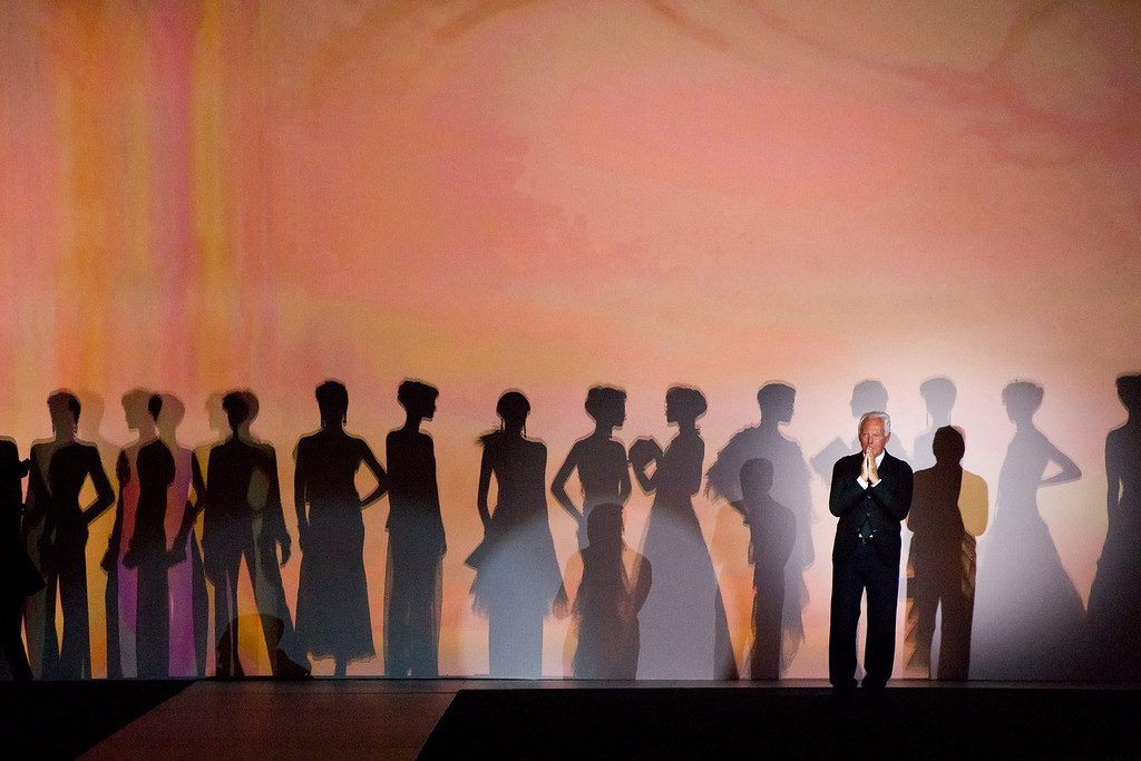 """. Giorgio Armani takes a bow at the conclusion of his \""""One Night Only New York� fashion show on Thursday, Oct. 24, 2013 in New York. (Photo by Charles Sykes/Invision/AP)"""