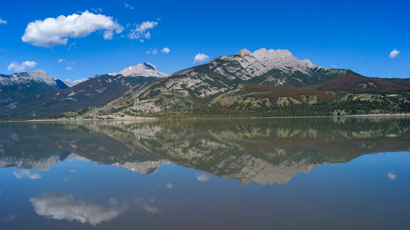 Reflection of mountains in Jasper Lake, Yellowhead Highway, Jasper National Park, Jasper, Alberta, Canada