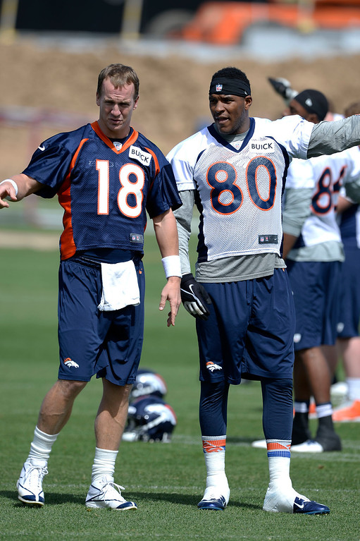 . Denver Broncos quarterback Peyton Manning (18) talks with TE Julius Thomas (80) during OTAs June 16, 2014 at Dove Valley. (Photo by John Leyba/The Denver Post)