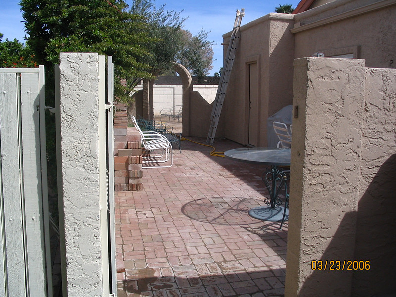 A view of the side yard through the gate.