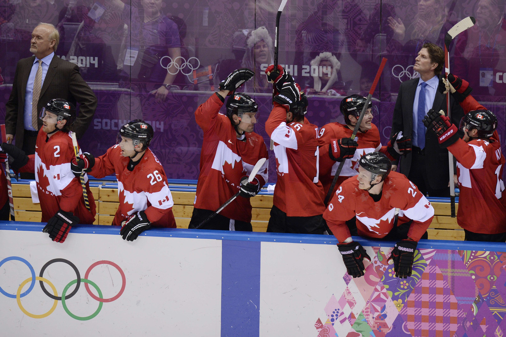 . Canada\'s players celebrate at the end of the Men\'s Ice Hockey Semifinals USA vs Canada at the Bolshoy Ice Dome during the Sochi Winter Olympics on February 21, 2014. Canada won 0-1.   ALEXANDER NEMENOV/AFP/Getty Images