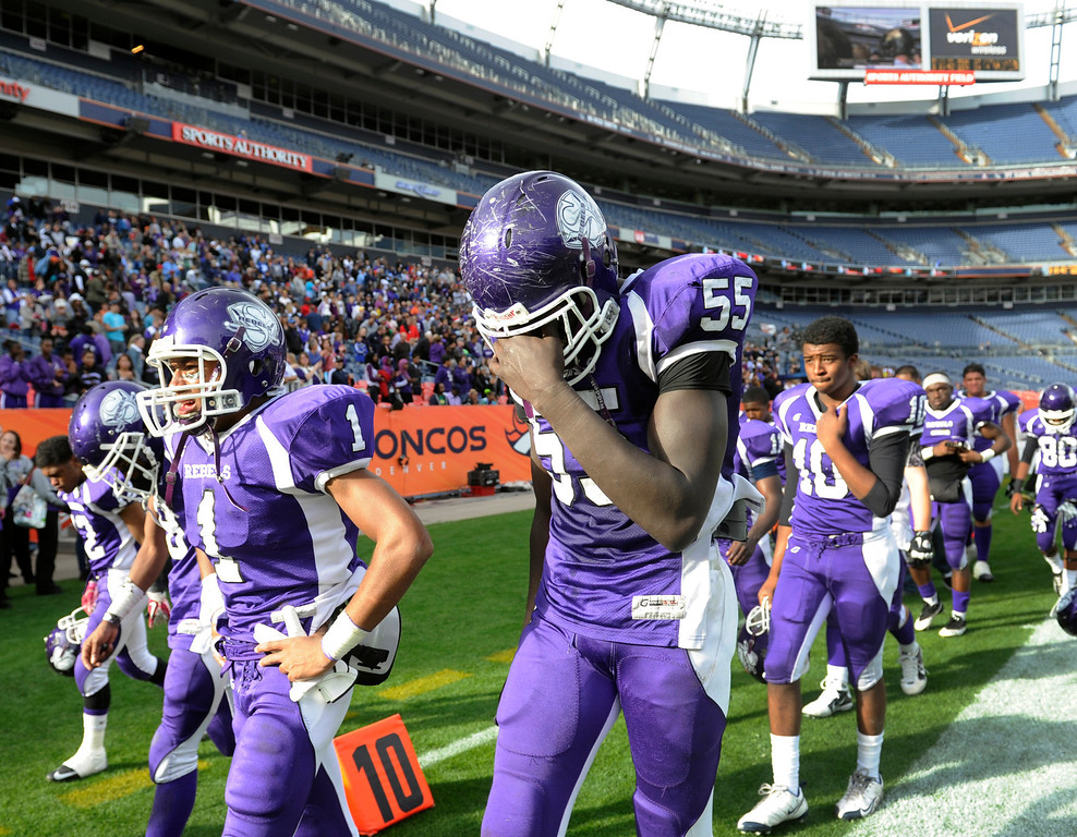 . After losing the game, Denver South\'s Samuel Mabany (55) leaves the field in tears with Shun Johnson (1) and the rest of the team. Denver South High School takes on Monarch High School in the second half in the 4A Colorado State Football Championships at Sports Authority Field at MIle High in Denver on Saturday, Dec. 1, 2012. Kathryn Scott Osler, The Denver Post