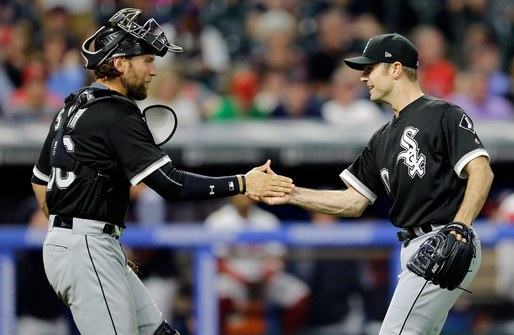 . Chicago White Sox relief pitcher David Robertson, right, is congratulated by catcher Kevan Smith after they defeated the Cleveland Indians in a baseball game, Saturday, June 10, 2017, in Cleveland. (AP Photo/Tony Dejak)