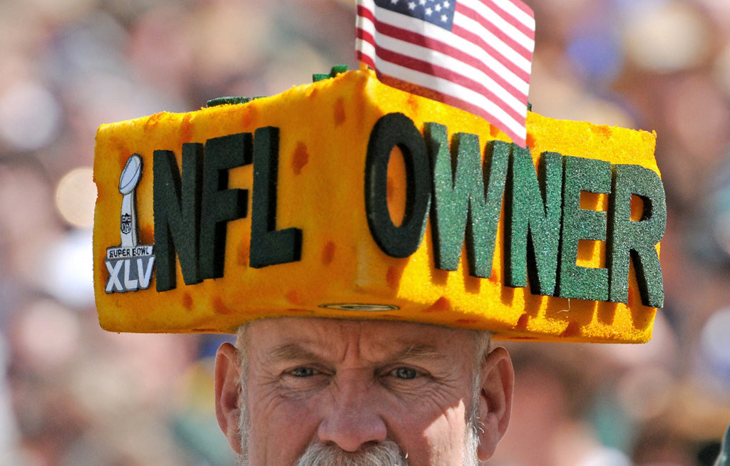 . Steve Tate of De Forest, Wis., attends the Green Bay Packers annual shareholders meeting at Lambeau Field in Green Bay, Wis., on Wednesday, July 24, 2013. (AP Photo/The Green Bay Press-Gazette, H. Marc Larson)