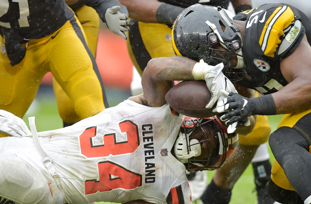 . Cleveland Browns running back Carlos Hyde (34) scores a one-yard touchdown during the second half of an NFL football game against the Pittsburgh Steelers, Sunday, Sept. 9, 2018, in Cleveland. (AP Photo/David Richard)