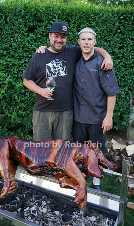 Alex von Salad and chef Kris Kastle showing off the fruits of their labor during the Petanque tournament and Pig Roast at La Maison Blance Hotel on June 29, 2014 in Shelter Island.  SocietyAllure.com/Rob Rich