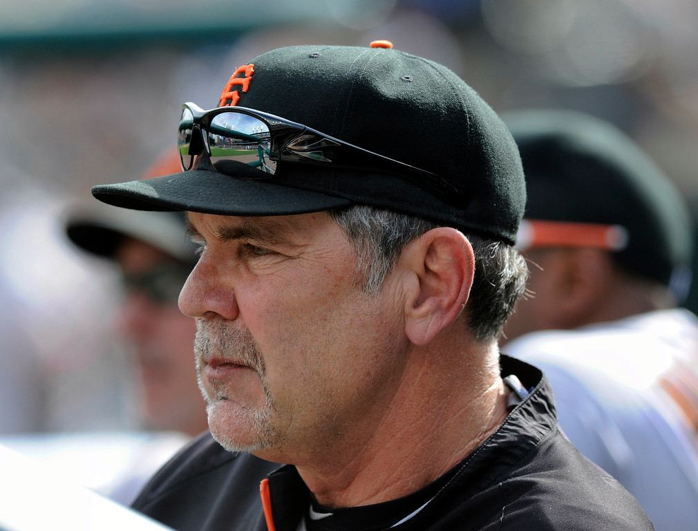 . San Francisco Giants manager Bruce Bochy watches his team play the Detroit Tigers in the ninth inning of a baseball game Saturday, Sept. 6, 2014, in Detroit. The Giants won 5-4.  (AP Photo/Jose Juarez)