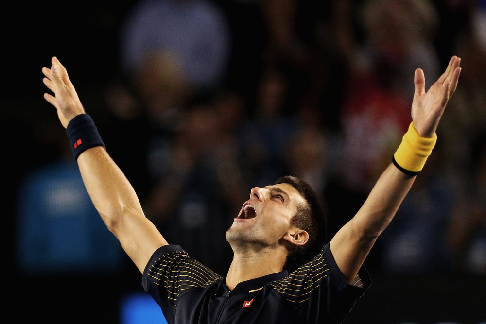 . Serbia\'s Novak Djokovic celebrates his win over Britain\'s Andy Murray in the men\'s final at the Australian Open tennis championship in Melbourne, Australia, Sunday, Jan. 27, 2013. (AP Photo/Robert Prezioso,Pool)