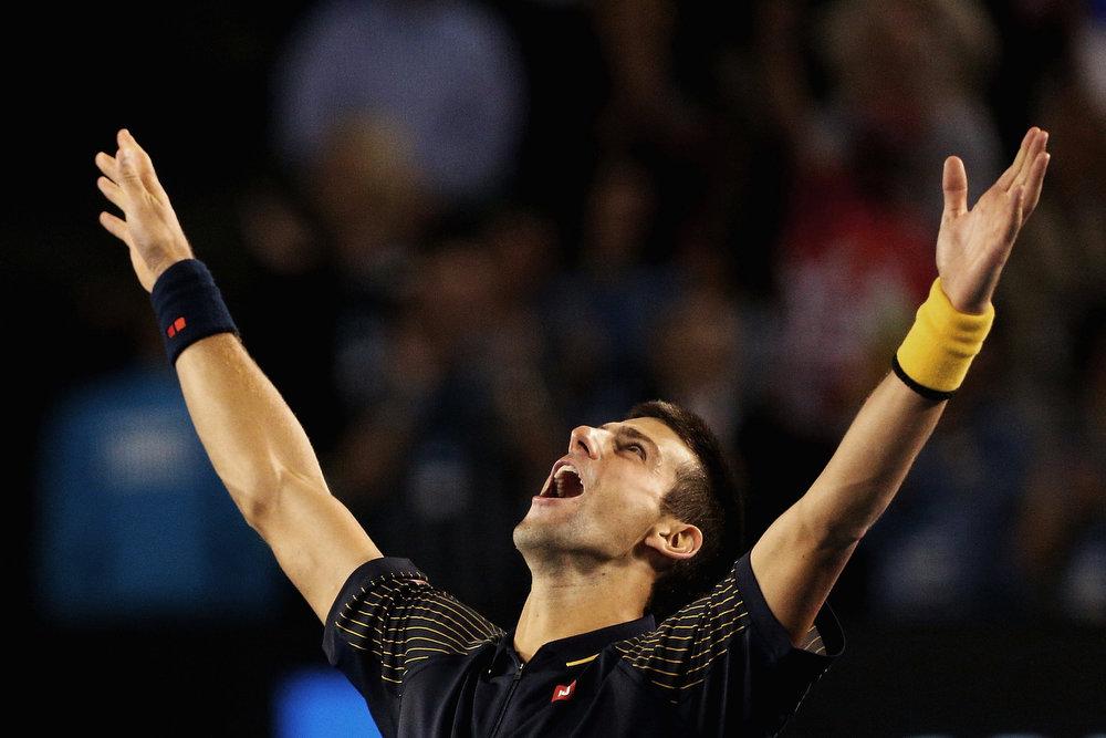 Description of . Serbia's Novak Djokovic celebrates his win over Britain's Andy Murray in the men's final at the Australian Open tennis championship in Melbourne, Australia, Sunday, Jan. 27, 2013. (AP Photo/Robert Prezioso,Pool)