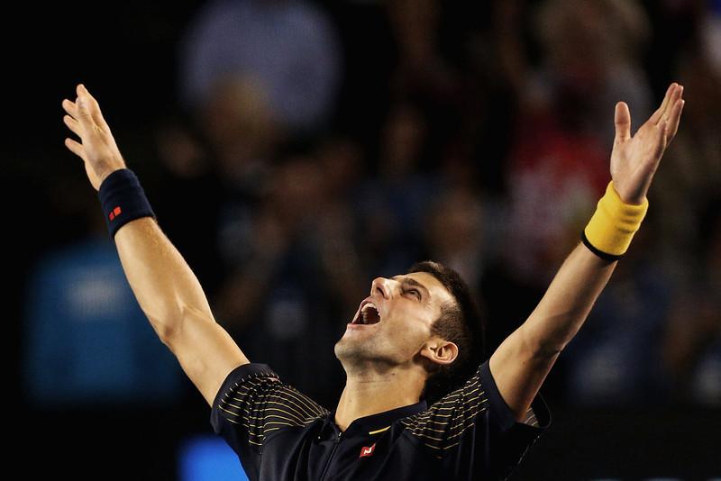 . Serbia\'s Novak Djokovic celebrates his win over Britain\'s Andy Murray in the men\'s final at the Australian Open tennis championship in Melbourne, Australia, Sunday, Jan. 27, 2013. (AP Photo/Robert Prezioso,Pool)