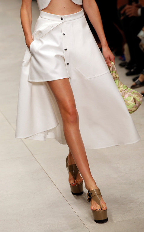. A model presents a creation as part of Carven\'s ready-to-wear Spring/Summer 2014 fashion collection presented in Paris, Thursday, Sept. 26, 2013. (AP Photo/Christophe Ena)