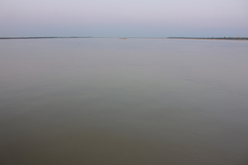 A lone boat on the Irrawaddy River at sundown