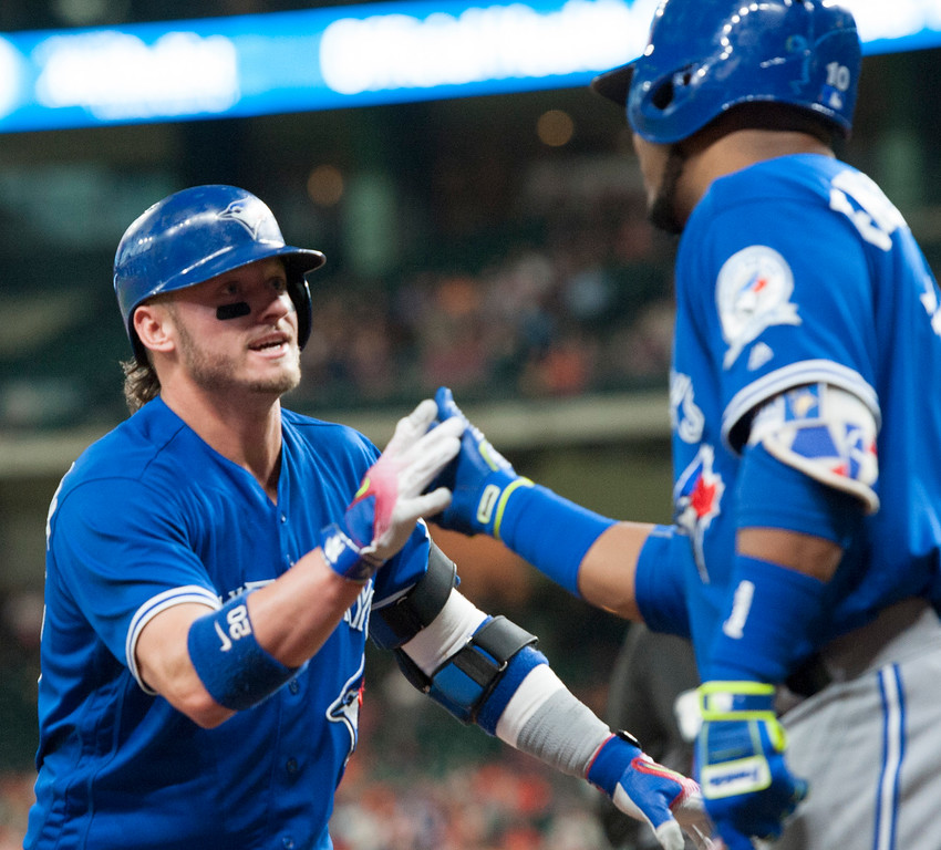 . Toronto Blue Jays third baseman Josh Donaldson, left, celebrates with Edwin Encarnacion after hitting a solo home run against the Houston Astros during the fourth inning of a baseball game Wednesday, Aug. 3, 2016, in Houston. (AP Photo/George Bridges)