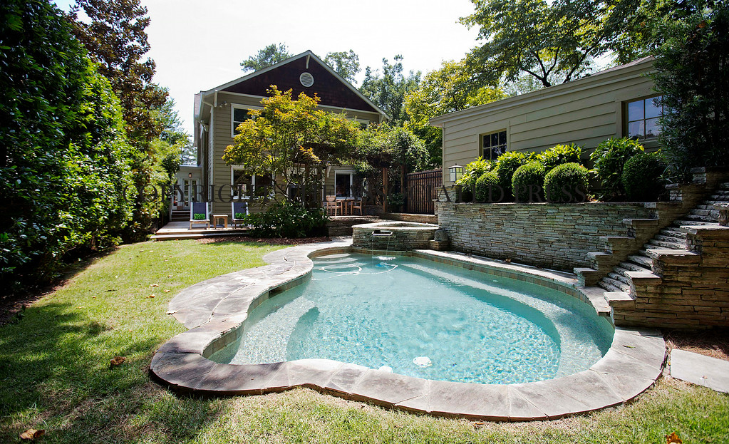 . This is an exterior view of the backyard patio and pool area of a three bedroom house listed for sale at $1,095,000 on Wednesday, July 30, 2014, in the Sherwood Forest neighborhood of Atlanta. The 2,551-square-foot house has two and a half bathrooms and features a detached garage. (AP Photo/David Goldman)
