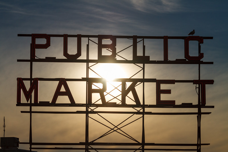 Public market sign lit from behind by the sun - Downtown Seattle, Seattle, Washington, United States (US)