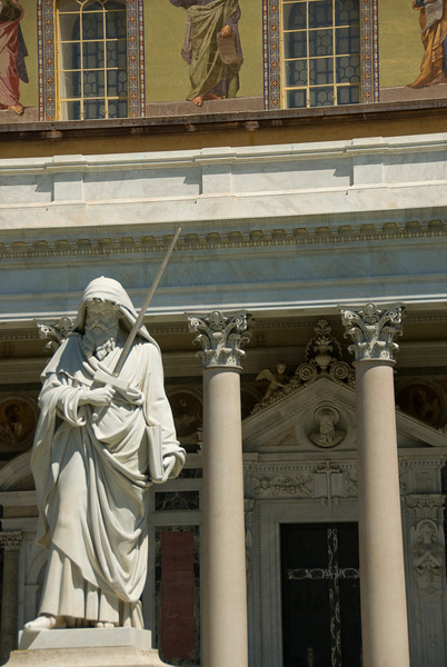 Statue of St. Paul holding a sword in front of St. Paul Outside the Walls church - Rome, Italy