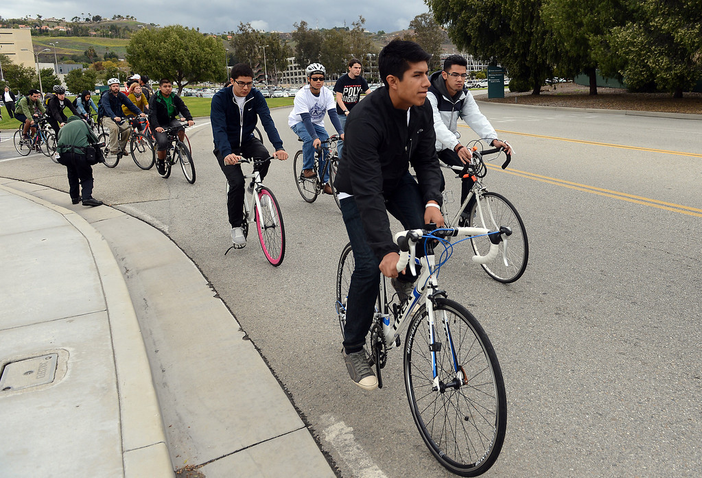 ". Friends and family gather to remember Cal Poly student Ivan Arturo Aguilar Thursday, March 7, 2013, at Cal Poly Pomona in Pomona. A ""ghost bike\"" was installed and a memorial bike ride was held in his memory. Aguilar was killed after he was hit by a car while riding his bike on campus last week. Jennifer Cappuccio Maher/Staff Photographer"