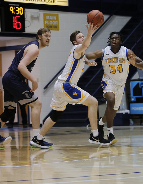 Photo by Matt Griffith/VU Vincennes University's Colton Sandage, center, reaches to control a loose ball away Olney Central's Jason Cudd, left, and the Blazers Chinedu Okanu, 34, looks on Wednesday night in the P.E. Complex.