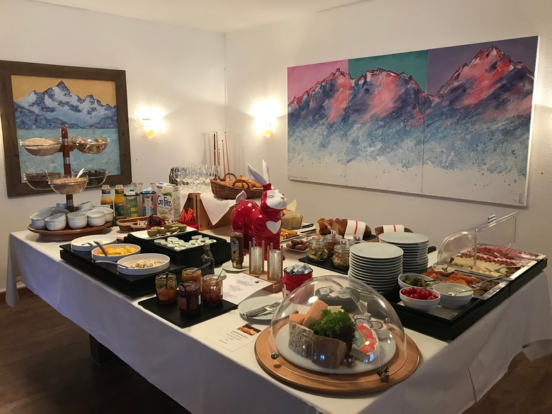Breakfast buffet at Hotel Schweizerhaus, with art for sale