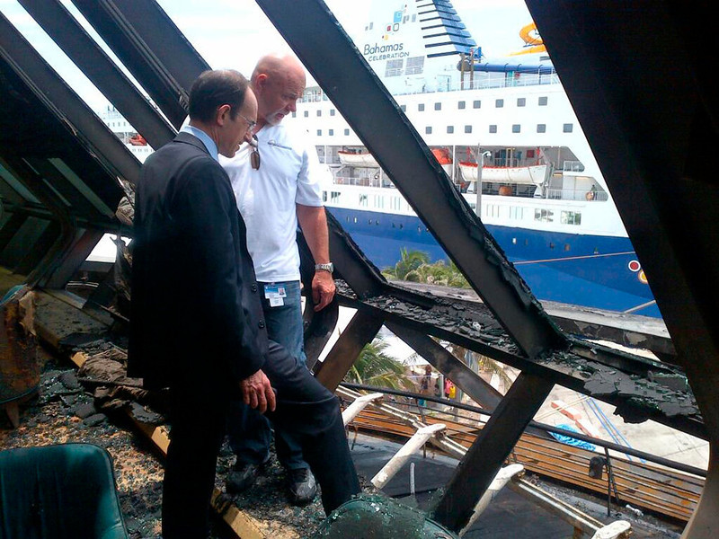 . Adam Goldstein (L), president and CEO of Royal Caribbean, and Anders Aasen of AVP Technical Services check out some of the damage on deck six of the Royal Caribbean ship Grandeur of the Seas as the ship is docked in Freeport, Bahamas in this May 27, 2013 handout photo. A fire broke out on the ship\'s aft mooring deck in the early hours of the morning May 27. The fire was extinguished at 0458 ET, and all 2,224 passengers and 796 crew members were accounted for, according to the company.  REUTERS/Royal Caribbean/Handout