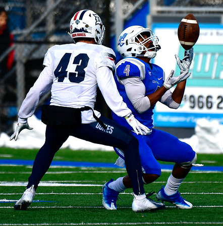 11/17/2018 Mike Orazzi | Staff CCSU's Tajik Bagley (4) and Duquesne's Peter Ausiello (43) at Arute Field in New Britain Saturday afternoon.