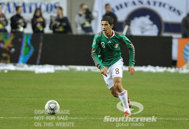 Mexico's Midfielder Israel Castro (#8) looks to pass during Soccer action between Bosnia-Herzegovina and Mexico.  Mexico defeated Bosnia-Herzegovina 2-0 in the game at the Georgia Dome in Atlanta, GA.