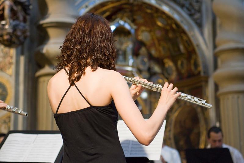 Girl playing the flute inside San Luis de los Franceses church, Seville, Spain