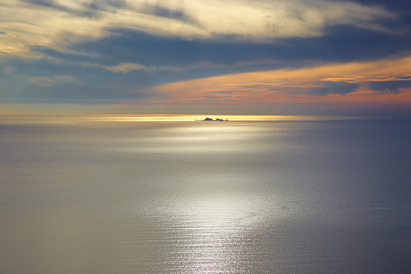 The sun lit a path over the sea to the Farallon islands, 17 miles off the Marin County Coast.  This only happens at very specific times so I feel fortunate to witness it!  This was taken 2,000 feet above sea level.