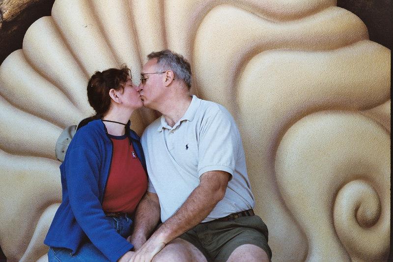 Linda and Paul kissing