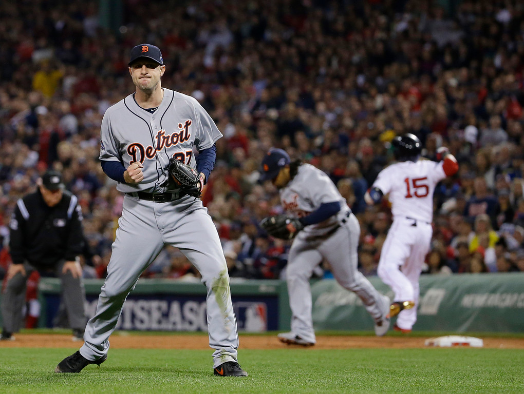 . Detroit Tigers starting pitcher Max Scherzer, left, celebrates after Boston Red Sox\'s Dustin Pedroia (15) hit into a double play to end the third inning in Game 6 of the American League baseball championship series on Saturday, Oct. 19, 2013, in Boston. (AP Photo/Matt Slocum)