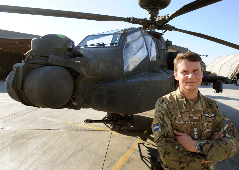 Description of . This picture taken on November 2, 2012 shows Colonel Neil Sexton, the Commander of the Joint Aviation Group (JAG), at the British controlled flight-line in Camp Bastion southern Afghanistan, overall Commander of Britain's Prince Harry who was serving as an Apache helicopter pilot/gunner with 662 Sqd Army Air Corps from September 2012 to January 2013. JOHN STILLWELL/AFP/Getty Images