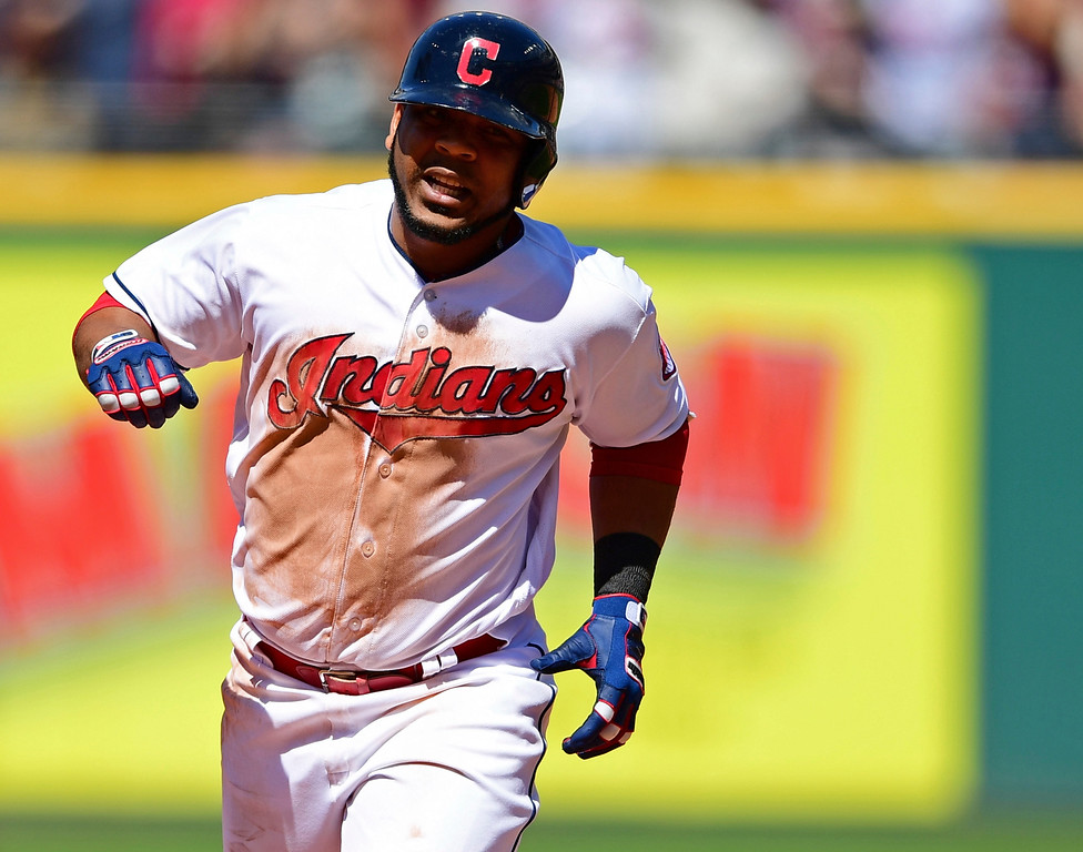 . Cleveland Indians\' Edwin Encarnacion runs the bases after hitting a grand slam off Detroit Tigers relief pitcher Artie Lewicki in the eighth inning of a baseball game, Sunday, June 24, 2018, in Cleveland. (AP Photo/David Dermer)