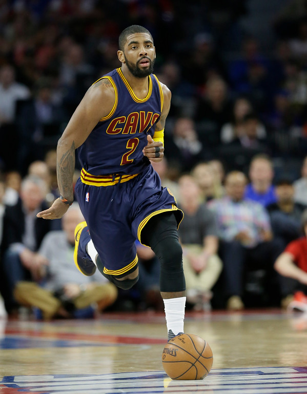 . Cleveland Cavaliers guard Kyrie Irving brings the ball up court during the first half in Game 4 of a first-round NBA basketball playoff series against the Detroit Pistons, Sunday, April 24, 2016 in Auburn Hills, Mich. (AP Photo/Carlos Osorio)