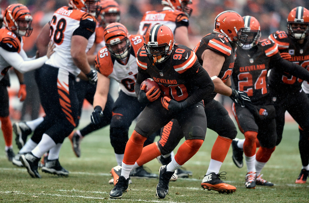 . Cleveland Browns outside linebacker Emmanuel Ogbah picks up a blocked extra point in the first half of an NFL football game against the Cincinnati Bengals, Sunday, Dec. 11, 2016, in Cleveland. (AP Photo/David Richard)
