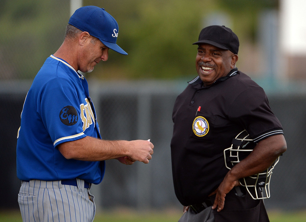 . San Dimas head coach Mike Regan talks with the home plate umpire in the sixth inning of a prep baseball game against Northview at Northview High School in Covina, Calif., on Wednesday, March 26, 2014. San Dimas won 2-0. (Keith Birmingham Pasadena Star-News)