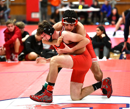 1/11/2020 Mike Orazzi | StaffrBerlin's Arban Asatourian and Branford's Spencer Lyon while wrestling Saturday at Berlin High School.