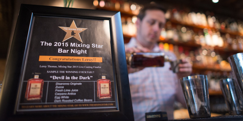 Visit Herb & Bitter Public House, one of the newest cocktail lounges in Seattle's Capital Hill neighborhood, to sample Devil in the Dark - and award-winning cocktail by bartender Leroy Thomas.  Seattle Event Photography by Ari Shapiro - AShapiroStudios.com