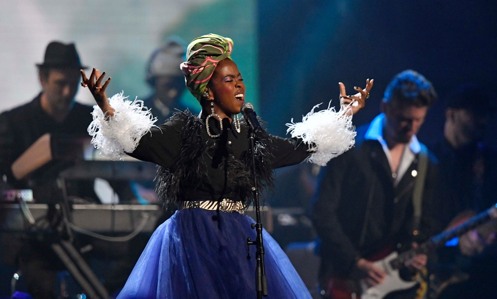 . Recording artist Lauryn Hill pays tribute to Nina Simone during the Rock and Roll Hall of Fame induction ceremony, Saturday, April 14, 2018, in Cleveland. (AP Photo/David Richard)