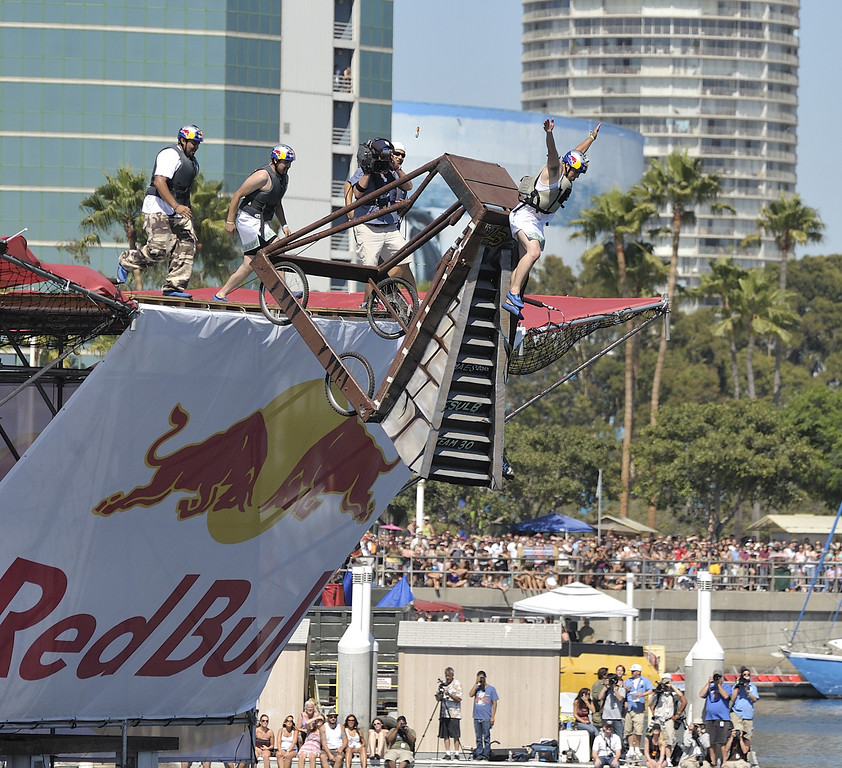 """. LONG BEACH, CALIF. USA -- Jaret Padilla pilots whats left of their Flugtag  \""""Flies Like a Butterfly, but Stings Like a Ray\"""" after it failed to roll down the ramp in Rainbow Harbor in Long Beach, Calif. on August 21, 2010. Thirty five teams competed in the Red Bull event where teams build homemade, human-powered flying machines and pilot them off a 30-foot high deck in hopes of achieving flight.  Flugtag means \""""flying day\"""" in German. They are on distance, creativity and showmanship..Photo by Jeff Gritchen / Long Beach Press-Telegram.."""