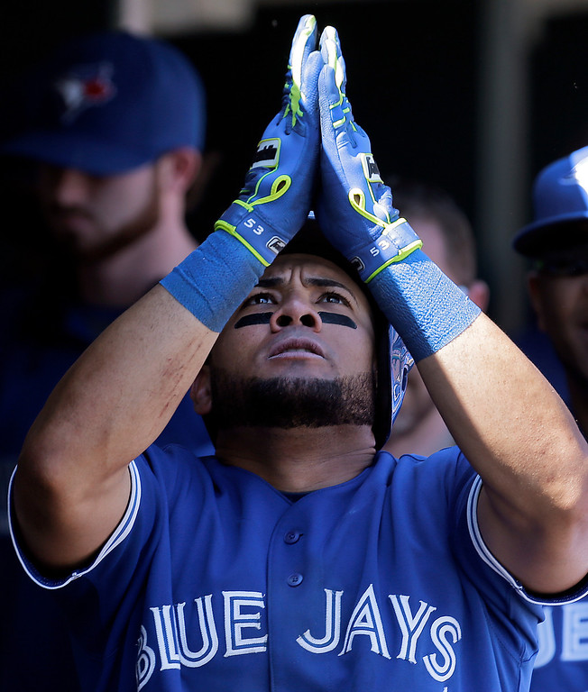 . Toronto Blue Jays\' Melky Cabrera celebrates his solo home run against the Detroit Tigers in the ninth inning of a baseball game in Detroit, Thursday, June 5, 2014. (AP Photo/Paul Sancya)
