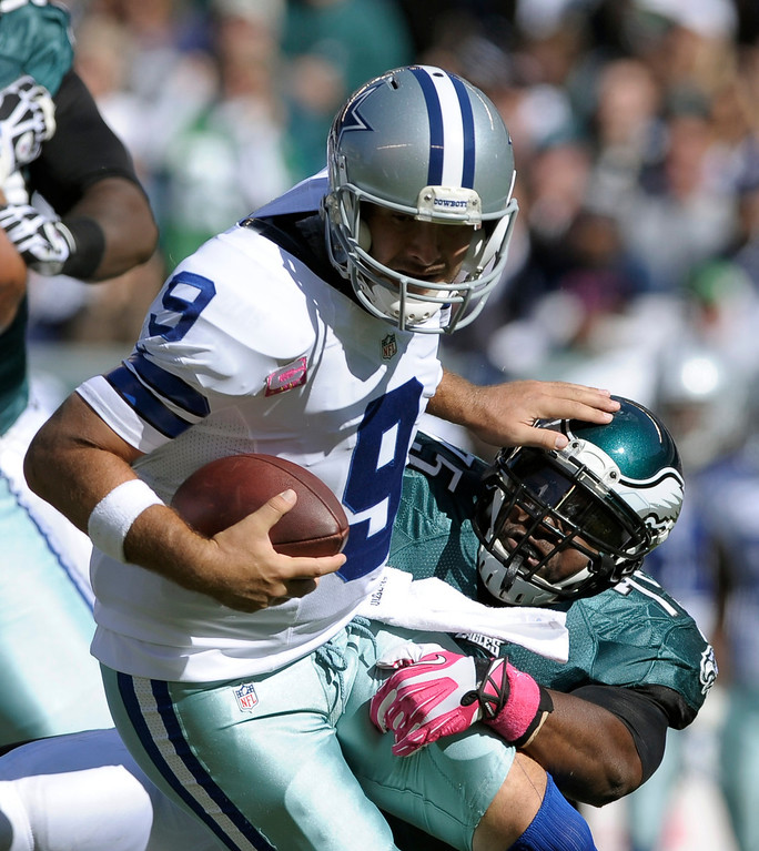 . Dallas Cowboys quarterback Tony Romo (9) is sacked by Philadelphia Eagles defensive end Vinny Curry (75) during the first half of an NFL football game, Sunday, Oct. 20, 2013, in Philadelphia. (AP Photo/Michael Perez)
