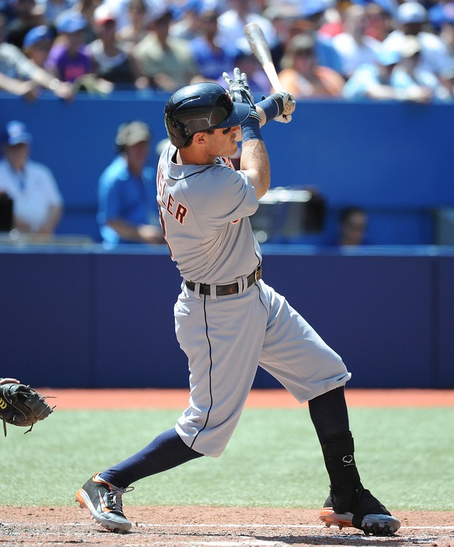 . Detroit Tigers\' Ian Kinsler hits a double, scoring Andrew Romine in the fourth inning against the Toronto Blue Jays  during a baseball game on Sunday, Aug. 10, 2014, in Toronto. (AP Photo/The Canadian Press, Jon Blacker)