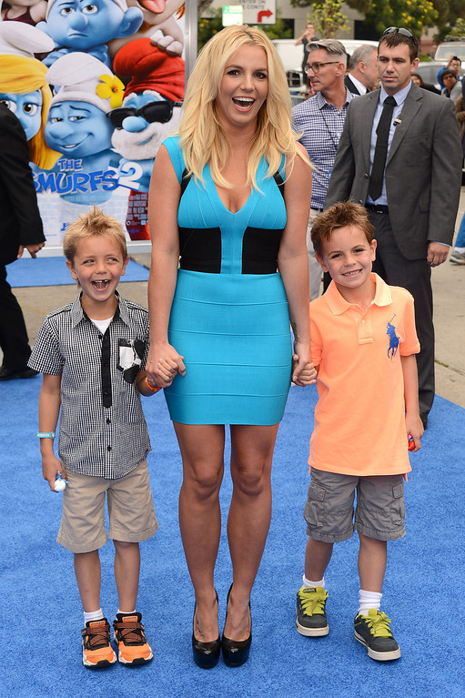 """. Britney Spears, center, with sons Sean Federline and Jayden James Federline arrives at the world premiere of \""""The Smurfs 2\"""" at the Regency Village Theatre on Sunday, July 28, 2013 in Los Angeles. (Photo by Jordan Strauss/Invision/AP)"""