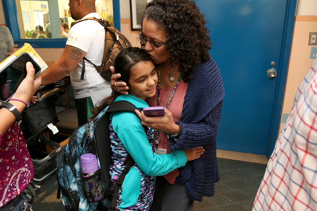 . The 2017-18 School year started  for Crocker Elementary School on Thursday, August 31, 2017. Gabriella Berberian, 9, who will be a fourth grader this year got a kiss from her grandmother Gloria Acosta just before starting her first day. SENTINEL & ENTERPRISE/JOHN LOVE
