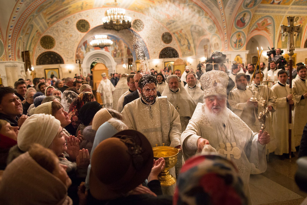 . Russian Orthodox Church Patriarch Kirill, right, blesses believers after an Orthodox Epiphany service at Christ The Savior Cathedral in Moscow, Russia, Monday, Jan. 18, 2016. Water that is blessed by a cleric on Epiphany is considered holy and pure until next year\'s celebration, and is believed to have special powers of protection and healing. The Russian Orthodox Church follows the old Julian calendar, according to which Epiphany falls on Jan. 19. (AP Photo/Alexander Zemlianichenko)