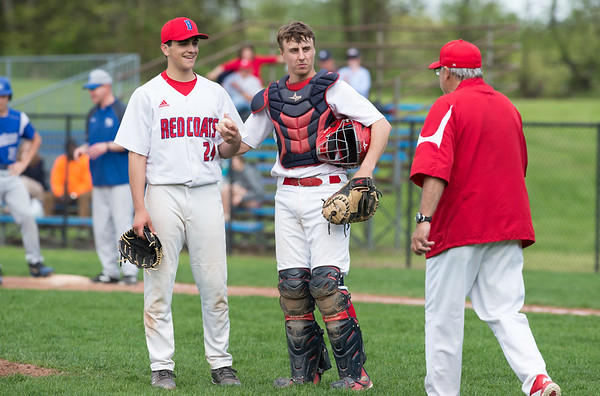 05/6/19 Wesley Bunnell | Staff Berlin baseball defeated Bristol Eastern at Sage Park on Tuesday afternoon. Mark Addamo (24) and Ryan Hyde (3) await head coach Leo Veleas as he prepares to make pitching change.