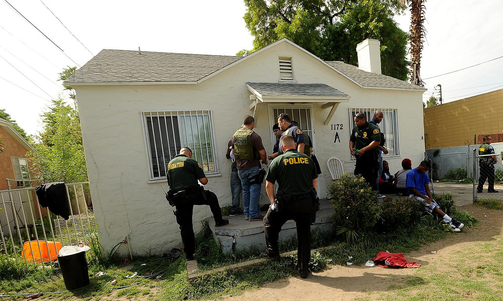 . SMASH unit officers conduct a sweep at a home along the 1100 block Mayfield Drive in San Bernardino April 4, 2013.GABRIEL LUIS ACOSTA/STAFF PHOTOGRAPHER.
