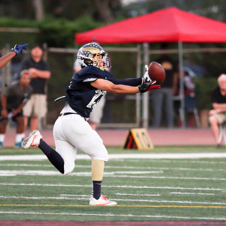 . South El Monte\'s Mario Burciaga (23) catches a long pass up the middle of the field during the 35th Annual Hall of Fame All-Star Football Game at West Covina High School in West Covina, CA on Friday, May 16, 2014. (SVGN/Correspondent Photo by David Thomas/SPORTS)